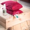 Aromateriapie s přírodním nosičem tepla, zelený polštářek ve tvaru šálu krásně sedí kolem krku.